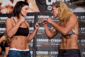 Photo: Esther Lin/Strikeforce - Carano (left) and Cyborg face off for real tomorrow in a scheduled five-round, 5-minute fight for the first Strikeforce Female 145-pound Championship.