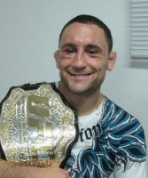 Frankie Edgar with his UFC lightweight championship belt.
