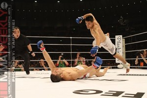 Escovedo (top) comes flying in to finish off Maeda after dropping him with a head kick at DREAM 13 (photo by MMAWeekly.com)