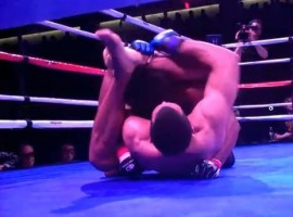 Magalhaes (bottom) uses the rubber guard to push out Knight's (top) right arm and start looking for a triangle or kimura.
