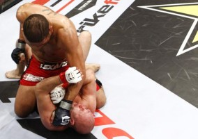 Antonio Silva (top) delivers some ground and pound on the way to a TKO win over Fedor Emelianenko. (Photo by Esther Lin/Strikeforce)