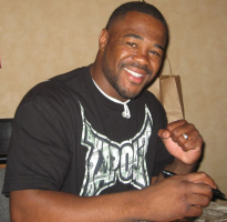 "The Ultimate Fighter season two winner, former UFC light heavyweight champion and current 205-pound number one contender, ""Suga"" Rashad Evans"