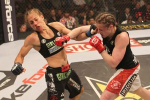 Sarah Kaufman (right) smashes Liz Carmouche with a big right hand en route to a unanimous decision win and a shot at the Strikeforce women's 135-pound title. Photo credit: Strikeforce