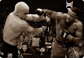 Tito Ortiz(left) taking a punch from Rashad Evans at UFC 73