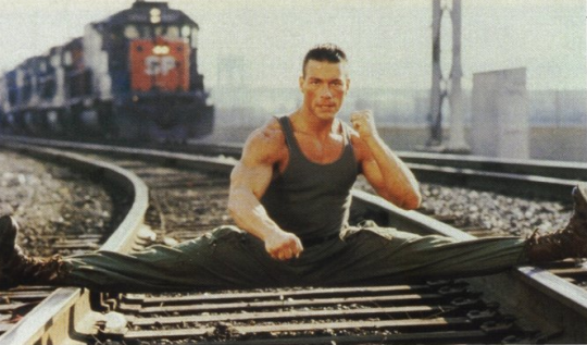 Doing the splits on train tracks may or may not help your MMA game. JCVD getting his stretch on.