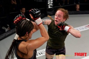 "Jessica ""Jag"" Aguilar and ""Little"" Patricia Vidonic go at it at Fight Time 9 in Ft. Lauderdale. Photo by Tom Hill"