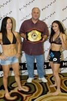 Promoter Craig Zimmerman with the Pandemonium Title. Photo courtesy of MEZSports.com