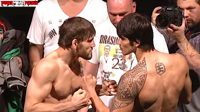 Jon Fitch (left) faces off against Erick Silva at the UFC 153 weigh-in's.