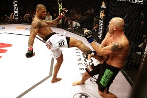 Tyrone Spong delivers a kick in his MMA debut last November