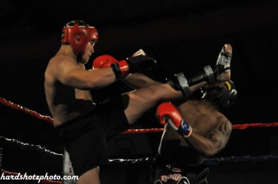 Evgeny Zotov using a front kick to take care of business at the Fit Factory Kickboxing Open 2011. Photo by Hardshotphoto.com via KMAA on Facebook