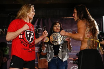 Marloes Coenen and Cris Cyborg - Marloes Coenen (left) faces off with longtime rival and fellow superstar Cris Cyborg (right) after the two weighed in for their much-anticipated main event rematch and the first-ever Invicta FC featherweight title fight.    (Photo Credit: Esther Lin / Invicta Fighting Championships)