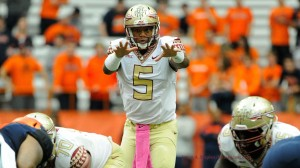 Oct 11, 2014; Syracuse, NY, USA; Florida State Seminoles quarterback Jameis Winston (5) calls a play at the line against the Syracuse Orange .