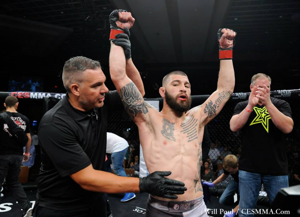 dinis-paiva-has-his-hands-raised-in-victory-1